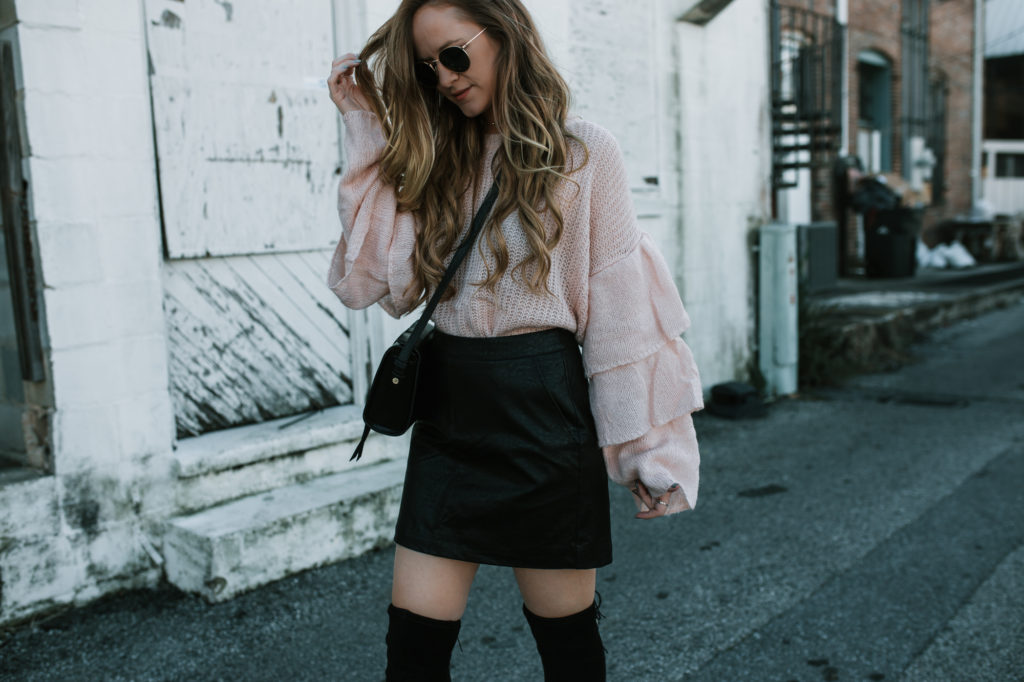 Shannon Jenkins from the blog Upbeat Soles styles a Tiered Bell Sleeve sweater from Chicwish with a high waisted leather skirt and over the knee boots