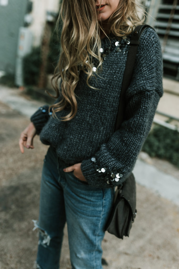 Shannon Jenkins from the blog Upbeat Soles styles an oversized sequin sweater from Chicwish with metallic booties and distressed high waisted Levis