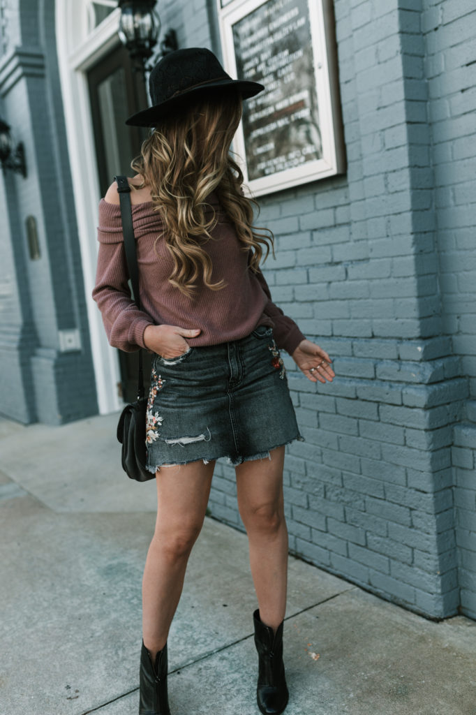 Shannon Jenkins from Upbeat Soles styles a casual date night outfit with an embroidered skirt Abercrombie with off the shoulder sweater and black booties