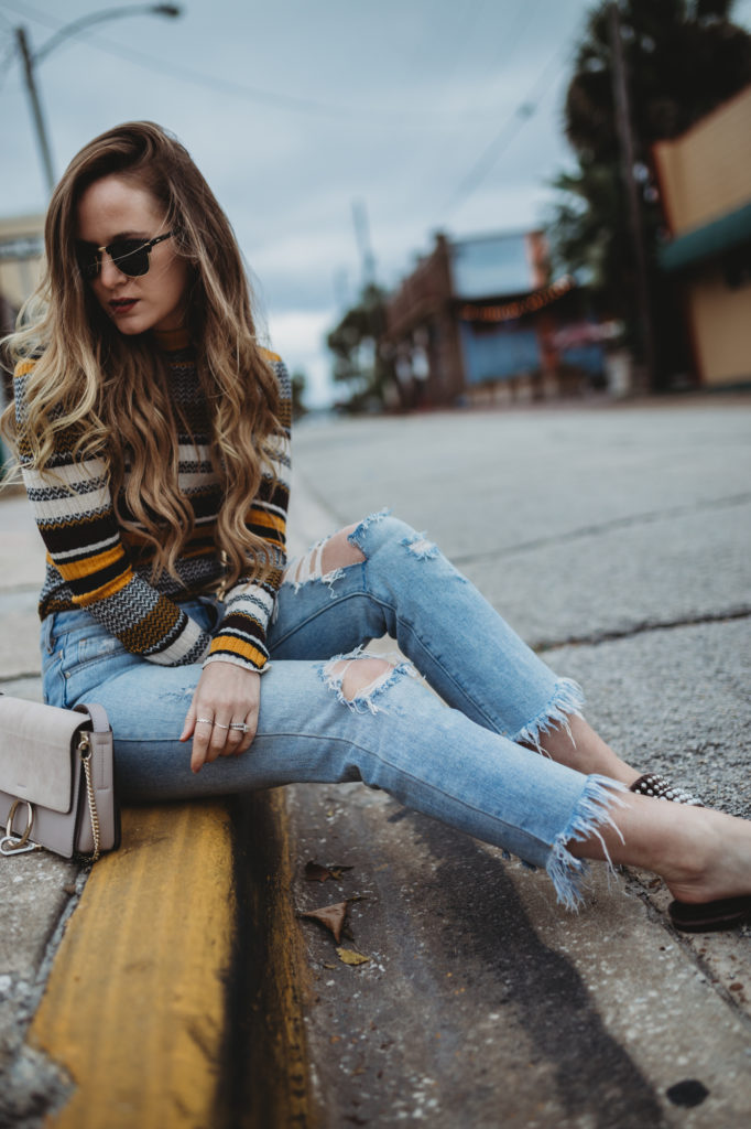 Shannon Jenkins of Upbeat Soles styles a retro winter outfit with striped turtleneck, distressed high waist jeans and Jefferey Campbell velvet pearl slides