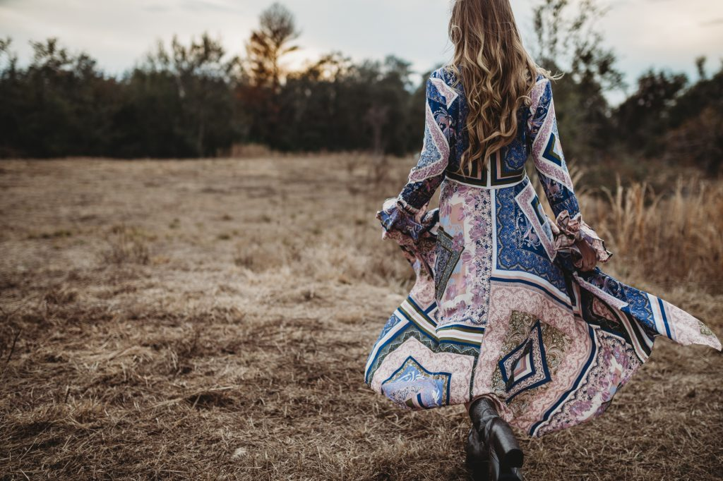Shannon Jenkins of Upbeat Soles styles a spring boho outfit with Free People patterned maxi dress, metallic booties, and Kendra Scott choker