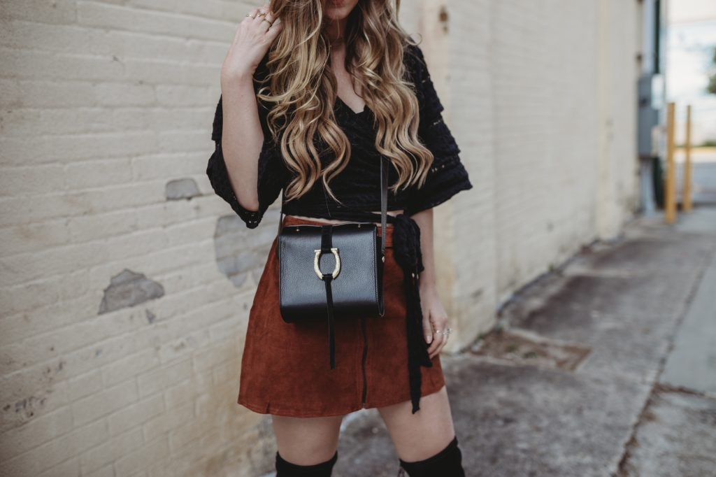 Shannon Jenkins from Upbeat Soles styles a spring boho outfit with a lace Free People top and suede high waisted skirt with over the knee boots
