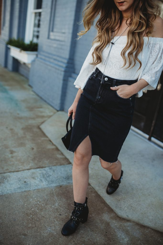 Shannon Jenkins of Upbeat Soles shows how to style studded booties with a spring date night outfit with Free People lace off the shoulder top, H&M denim skirt, Rebecca Minkoff studded booties, and Hieleven bag