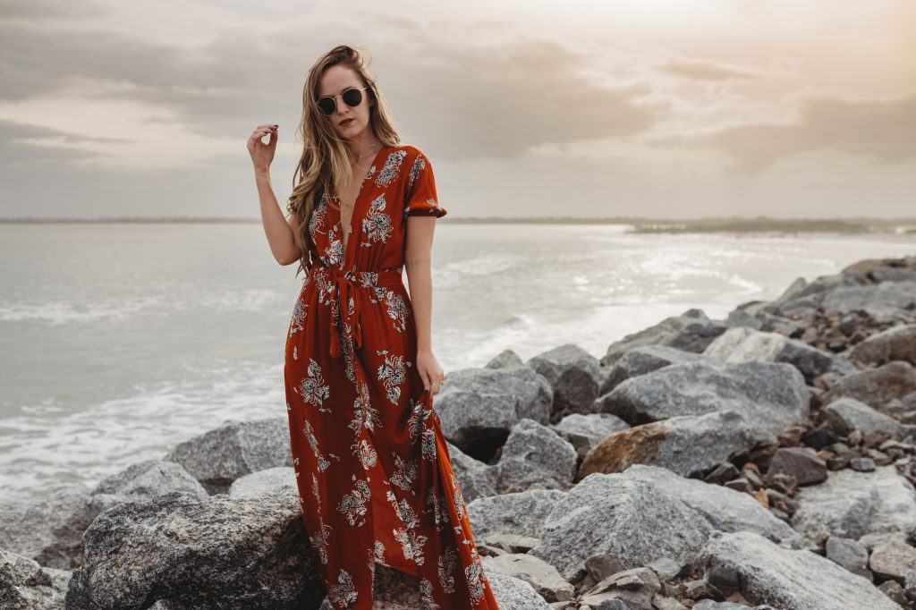 Shannon Jenkins of Upbeat Soles styles a cute vacation outfit with orange floral maxi dress from The Label Orlando with round Ray Ban sunglasses