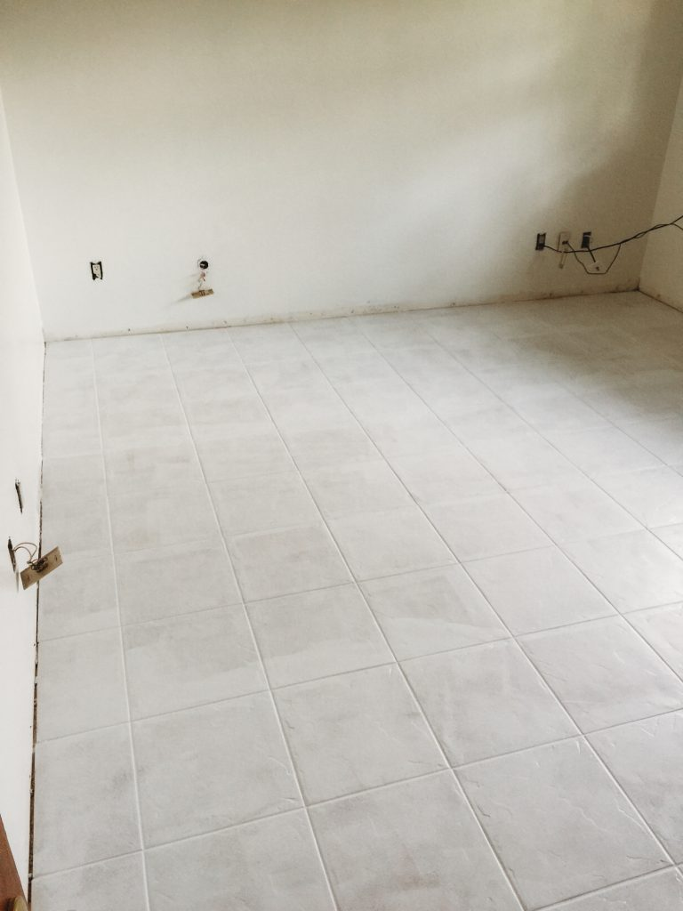 Shannon Jenkins from the blog Upbeat Soles shares a DIY project on how to paint tile floor with tile floor paint