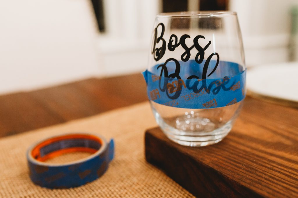 Shannon Jenkins from the blog Upbeat Soles shows how to make a DIY glitter wine glass that says Boss Babe for an easy gift idea