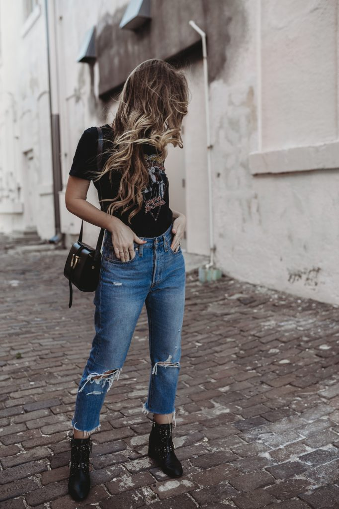 Shannon Jenkins from Fashion Blog Upbeat Soles Styles a vintage graphic tee with distressed Levis and studded booties for a casual look
