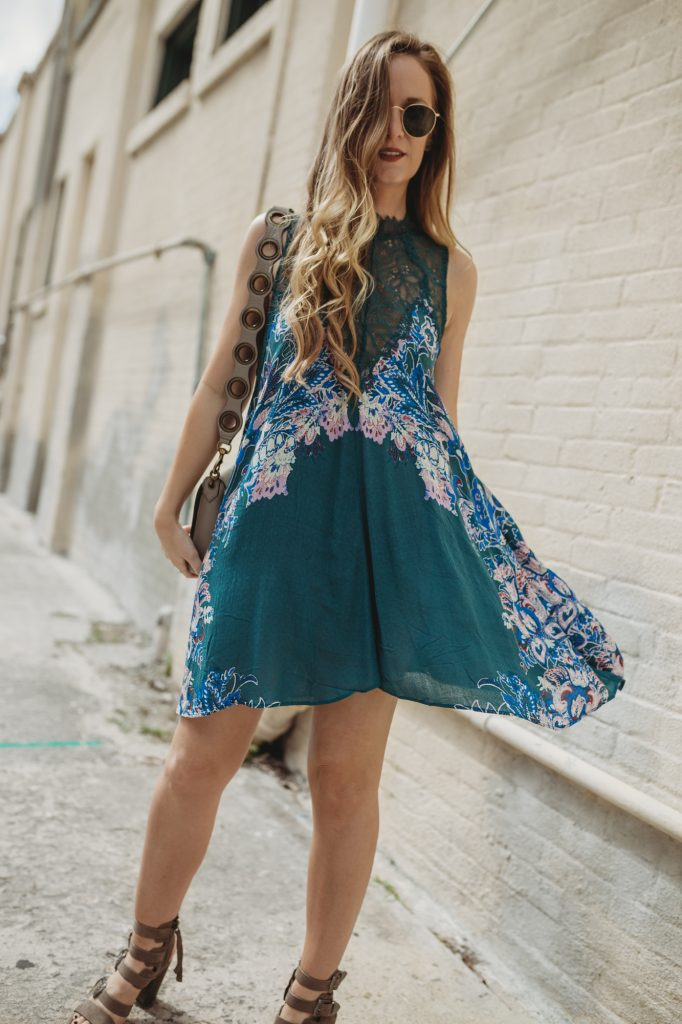 Shannon Jenkins from Florida fashion blog Upbeat Soles styles a spring boho dress from Free People and block heeled Dolce Vita buckle sandals
