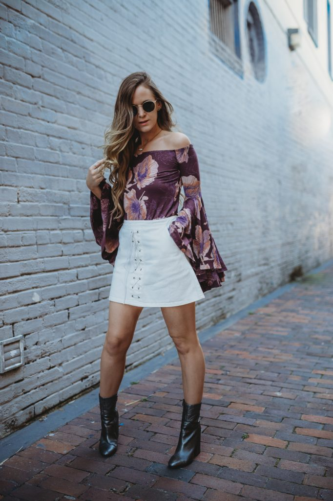 Shannon Jenkins of Upbeat Soles styles a boho weekend outfit with Free People off the shoulder bell sleeve top, lace up denim skirt, and metallic booties