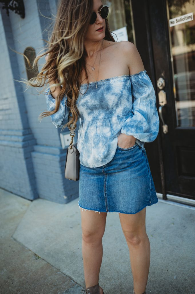 Shannon Jenkins of Upbeat Soles styles a spring weekend outfit with tie dye off the shoulder top, Blank NYC denim skirt, Jefferey Campbell lace up wedges, and Rebecca Minkoff crossbody bag