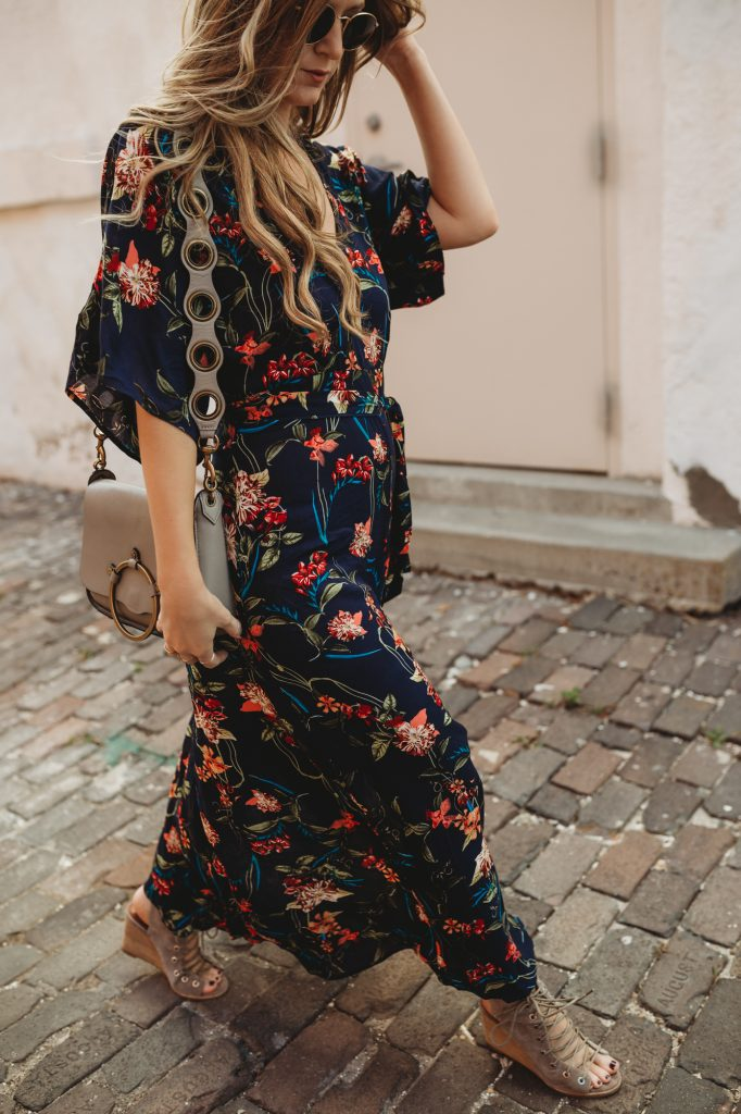 Shannon Jenkins of Upbeat Soles styles an edgy spring outfit with floral maxi dress, lace up Jefferey Campbell wedges, Rebecca Minkoff ring bag, and Ray Ban Icons