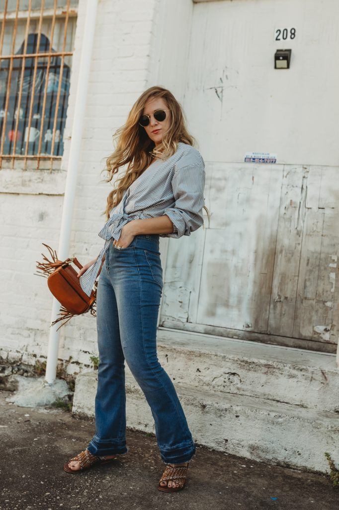 Shannon Jenkins of Upbeat Soles styles a retro spring look with striped wrap crop top from Sugarhigh and high waisted flared jeans