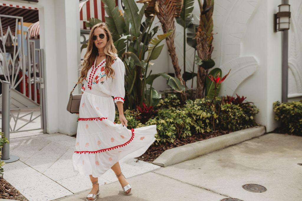 Shannon Jenkins of Upbeat Soles styles Cinco de Mayo inspired outfit with Chicwish pom pom maxi dress, Rebecca Minkoff lace up sandals, and Ray Ban Icons