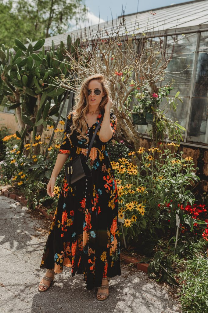 Shannon Jenkins of Upbeat Soles styles a cute vacation outfit with spring floral maxi dress, Dolce Vita studded sandals, and Sancia crossbody bag
