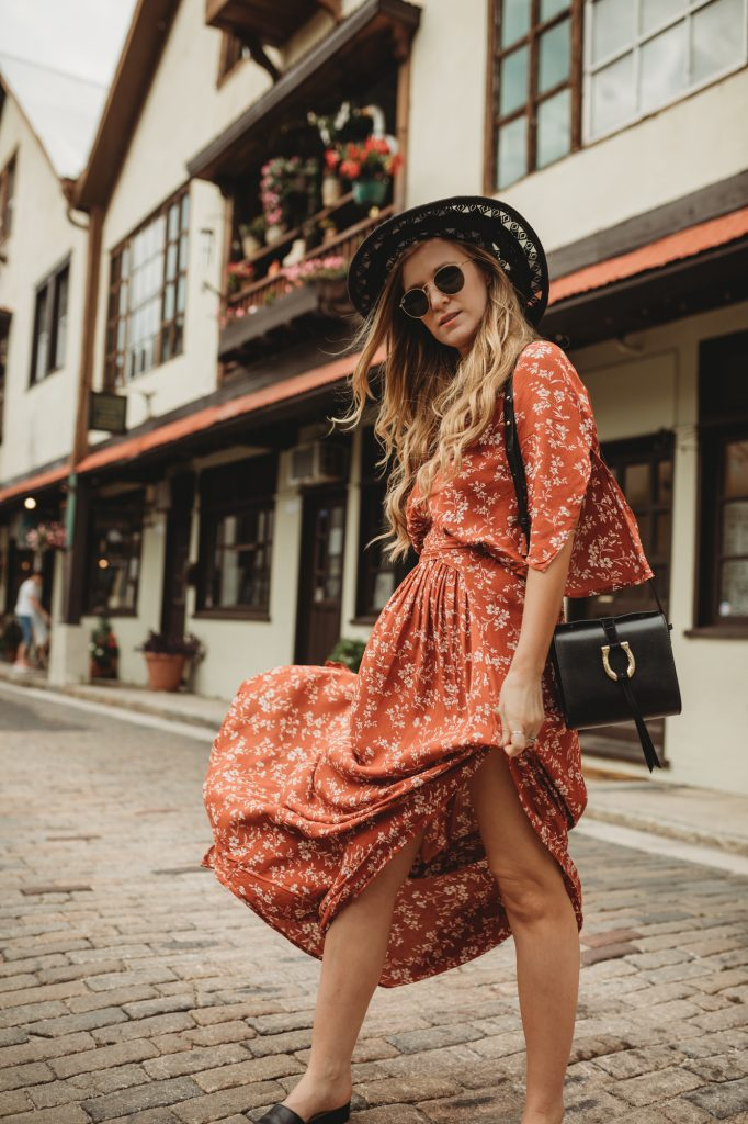 Shannon Jenkins of Upbeat Soles styles a spring bohemian outfit with shein orange floral maxi dress, Naturalizer slide sandals, and Sancia crossbody bag