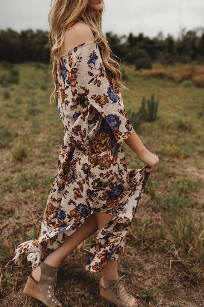 Shannon Jenkins of Upbeat Soles styles a floral boho maxi dress that's perfect for Summer with Jefferey Campbell lace up wedges and round Ray Ban sunglasses