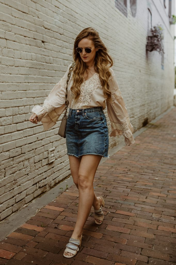 Shannon Jenkins of Upbeat Soles styles a lace and pearl bell sleeve top from Chicwish with Blank NYC denim skirt, Rebecca minkoff ring bag, and round Ray Ban sunglasses