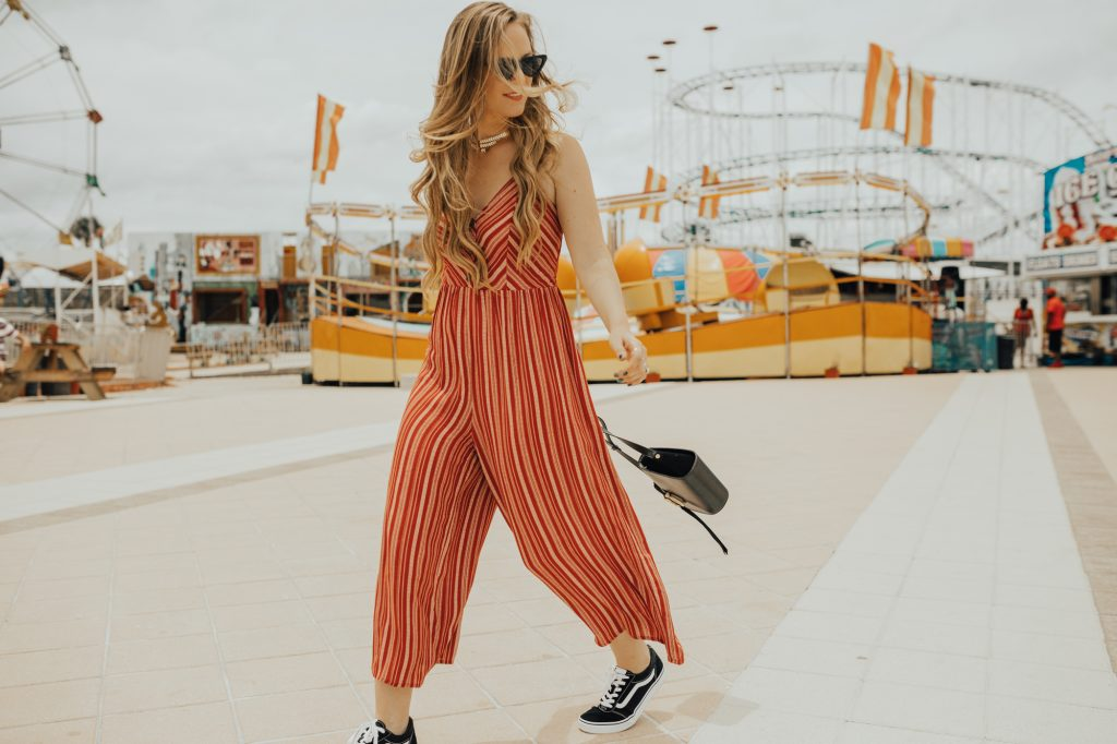 Shannon Jenkins from Florida fashion blog Upbeat Soles styles a cute theme park outfit with a Forever 21 red striped jumpsuit with old school vans and cat eye sunglasses