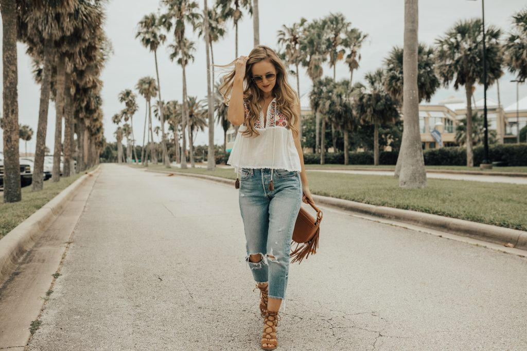Shannon Jenkins from fashion blog Upbeat Soles styles a Free People embroidered top with Levi distressed cropped jeans and lace up sandals