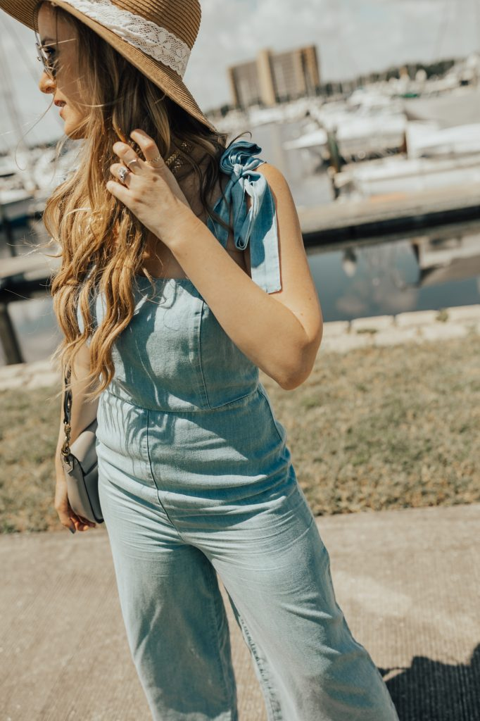 Shannon Jenkins of Upbeat Soles styles a summer jumpsuit outfit with a Forever 21 chambray jumpsuit, Jefferey campbell lace up shoes, and round Ray Ban sunglasses