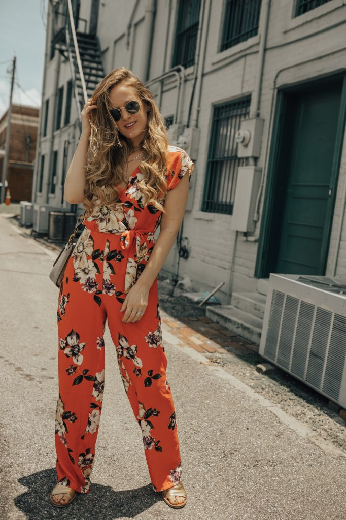 Shannon Jenkins of Upbeat Soles doe a Secret Clinical Strength review and styles a floral summer jumpsuit from Forever 21 with gold Free People sandals, and ring Rebecca Minkoff bag