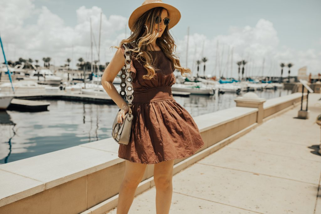Shannon Jenkins from fashion blog Upbeat Soles styles a Free People backless summer dress with lace up wedges
