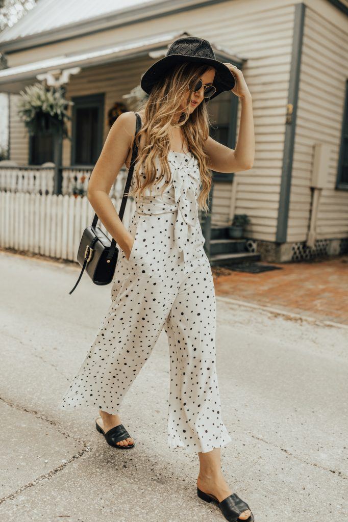 Shannon Jenkins of Upbeat Soles styles a cute summer weekend outfit with Chicwish polka dot jumpsuit, Naturalizer slides, Sancia bag, and Ray Ban round sunglasses