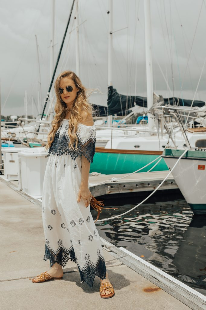 Shannon Jenkins of Upbeat Soles styles a a cute summer vacation outfit with Chicwish lace maxi dress, Matt Bernson sandals, and round Ray Ban sunglasses