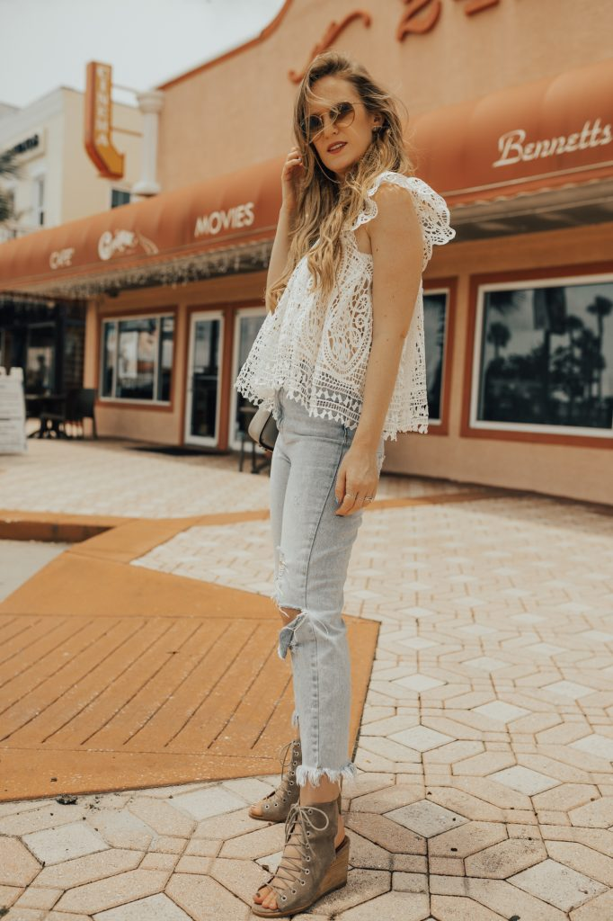 Shannon Jenkins of Upbeat Soles styles a cute summer outfit with Chicwish ruffle lace top, high waisted mom jeans, and Jefferey Campbell lace up wedges.