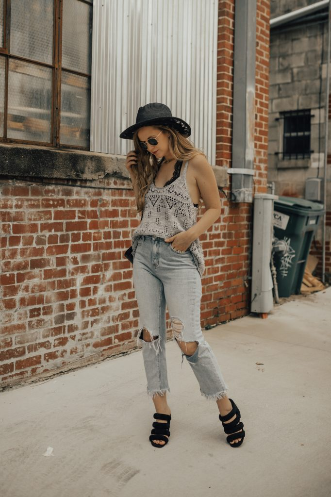 Shannon Jenkins of Upbeat Soles styles a laid back summer boho outfit with high waisted mom jeans, Candie's bralette, and Kelsi Dagger sandals