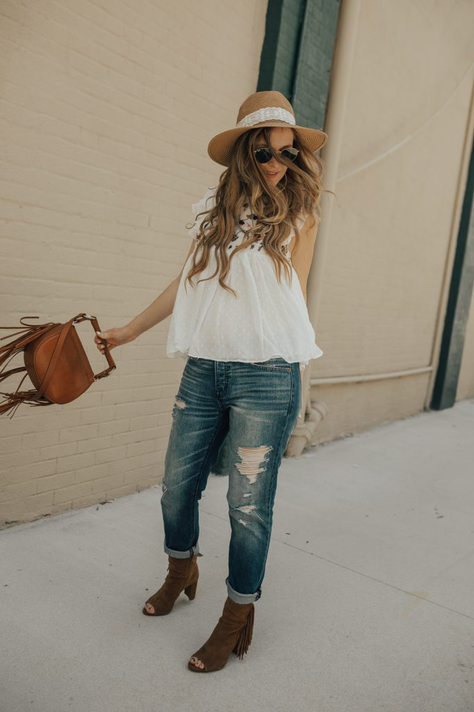 Shannon Jenkins of Upbeat Soles styles a boho casual weekend outfit with embroidered babydoll top, Abercrombie boyfriend jeans, and peep toe fringe booties