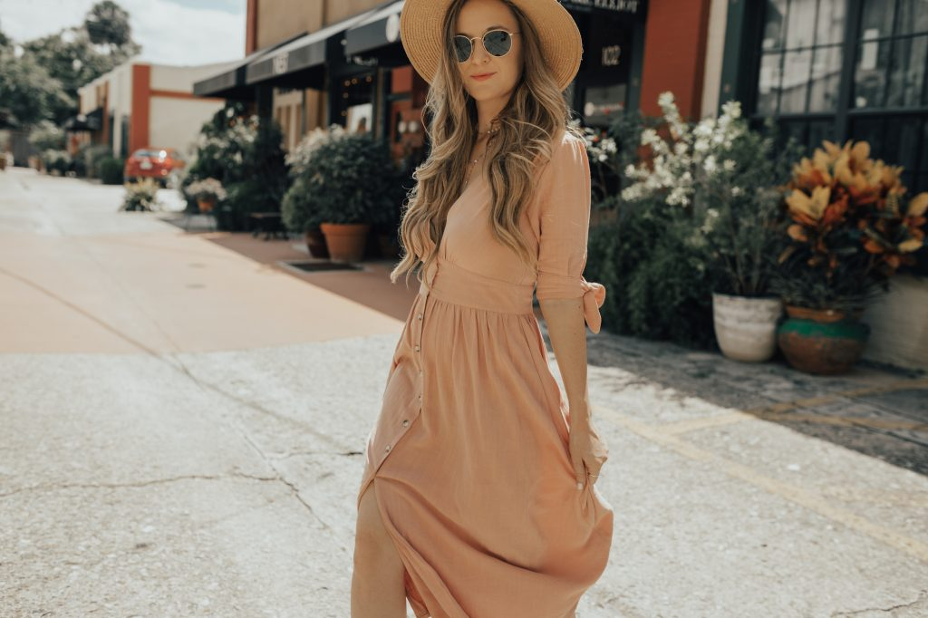 Shannon Jenkins of Upbeat Soles styles a cute summer maternity outfit with blush Chicwish midi dress, Dolce Vita block heels, and straw hat