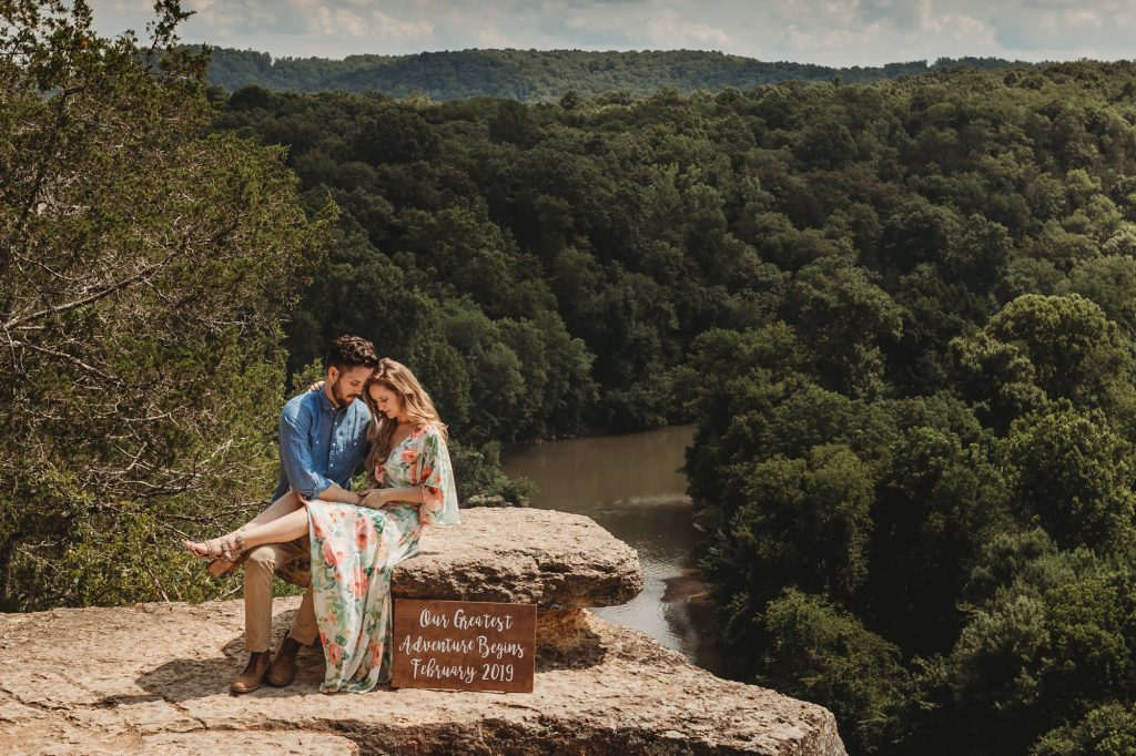 Shannon Jenkins of Upbeat Soles does a cute and dreamy baby announcement in Nashville, TN with a Yumi Kim floral maxi dress and cute baby announcement sign