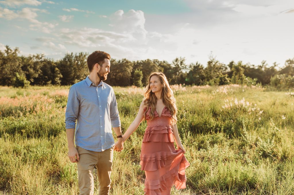 Shannon Jenkins of Upbeat Soles does a cute gender reveal smoke bomb photoshoot with a Glamorous Shopbop ruffled maxi dress