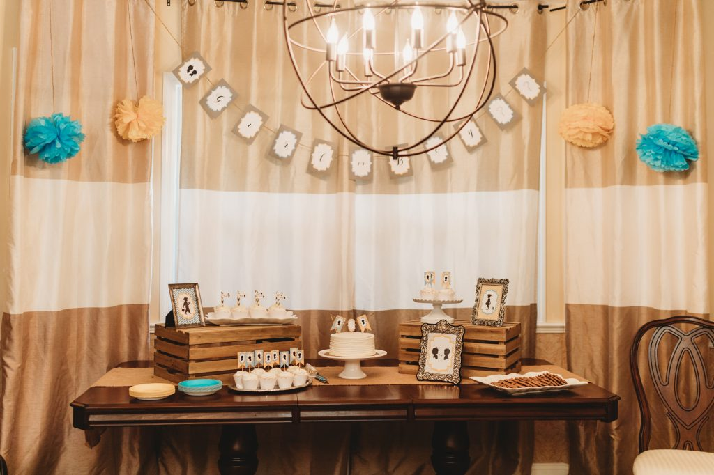 Shannon Jenkins of Upbeat Soles talks about her vintage style DIY gender reveal party with a blue and yellow theme, silhouettes, and mimosa bar