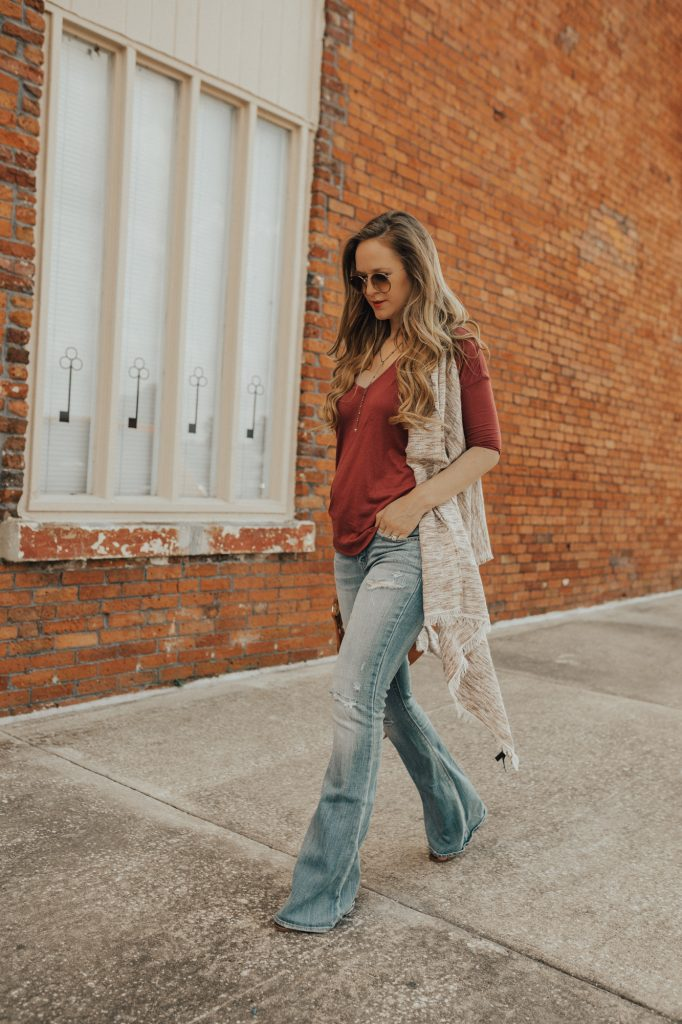 Shannon Jenkins of Upbeat Soles styes a fall maternity outfit with Express cardigan, and AE flared jeans, and does a review of Burt's Bees liquid lipstick