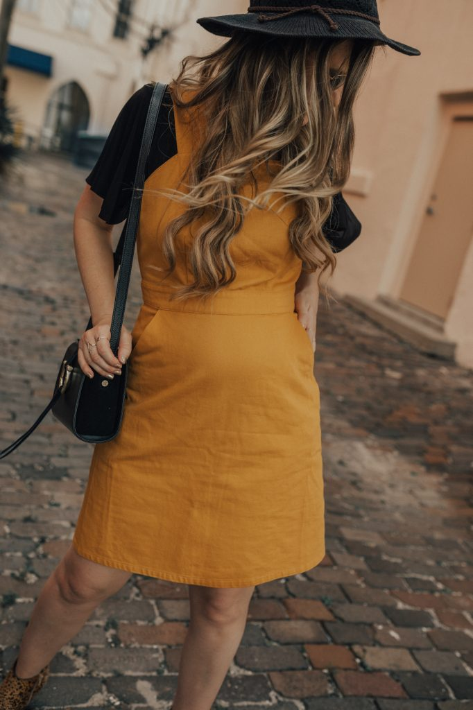 Shannon Jenkins of Upbeat Soles styles a fall maternity outfit with mustard denim dress, Matisse leopard booties, and Icon Ray Bans