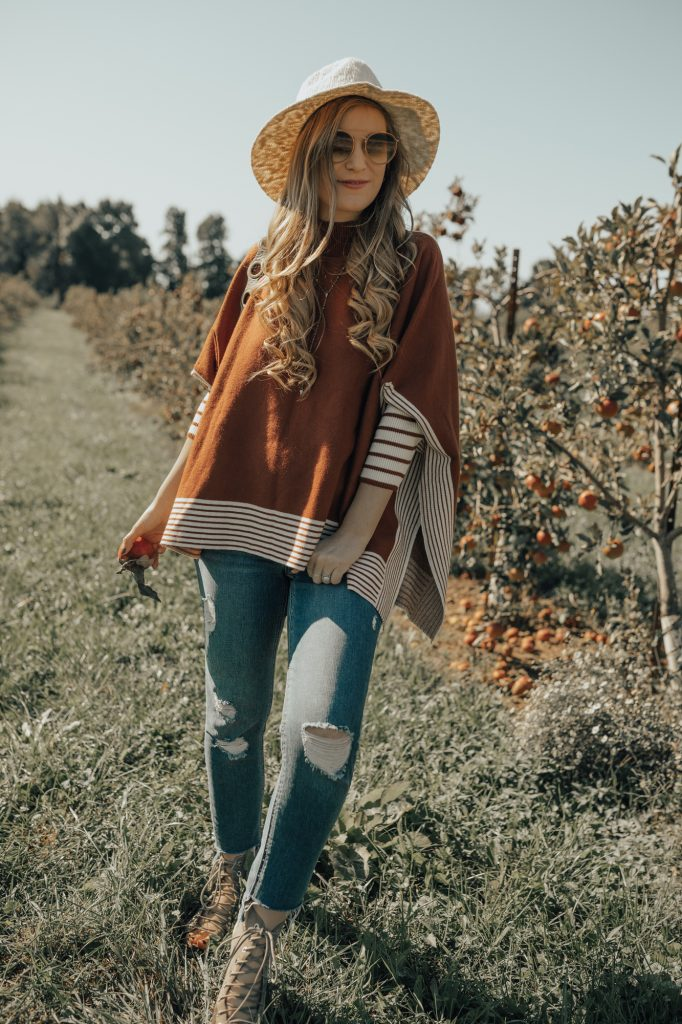 Shannon Jenkins of Upbeat Soles styles a fall maternity outfit with Chicwish burnt orange poncho, distressed maternity jeans, and lace up wedges