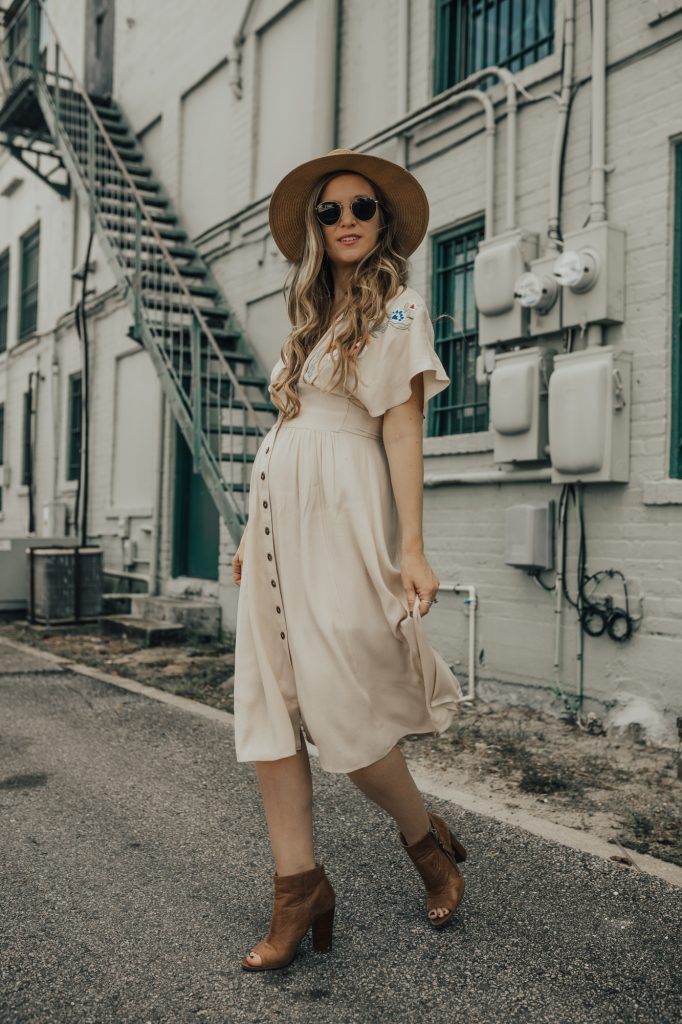 Shannon Jenkins of Upbeat Soles styles a fall boho maternity outfit with Adelyn Rae embroidered dress, peep toe booties, Sancia crossbody and round Ray Bans