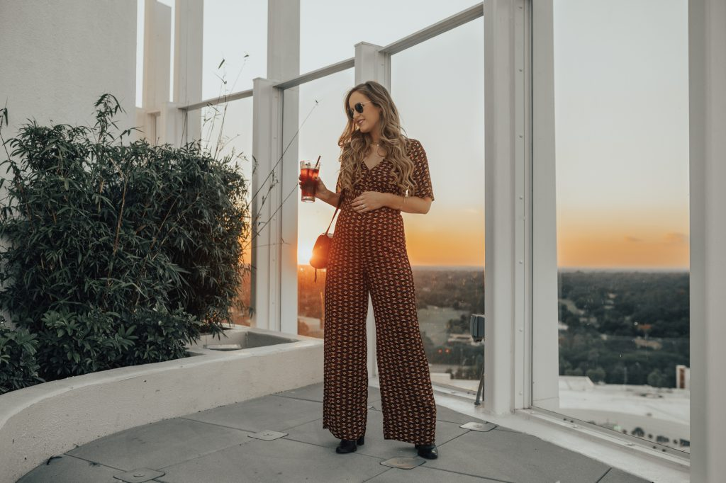 Shannon Jenkins of upbeat soles shows how to style a jumpsuit while preganant with a Forever 21 fall jumpsuit and Schutz black ankle booties