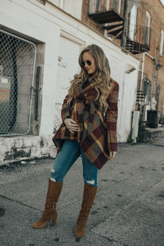 Shannon Jenkins of Upbeat Soles styles a winter maternity outfit with Chicwish plaid wool coat, distressed maternity jeans, and suede knee boots