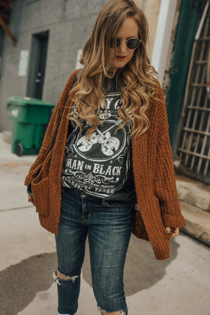 Shannon Jenkins of Upbeat Soles styles an edgy fall maternity outfit with Moon River cardigan, Target band tee, and white ankle booties