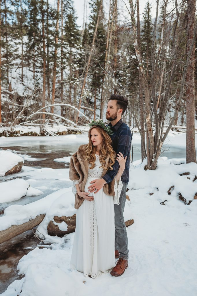 Shannon Jenkins of Upbeat Soles shows her Winter Colorado Maternity pictures with Fillyboo I Believe in Unicorns dress at Grand Lake Adams Falls