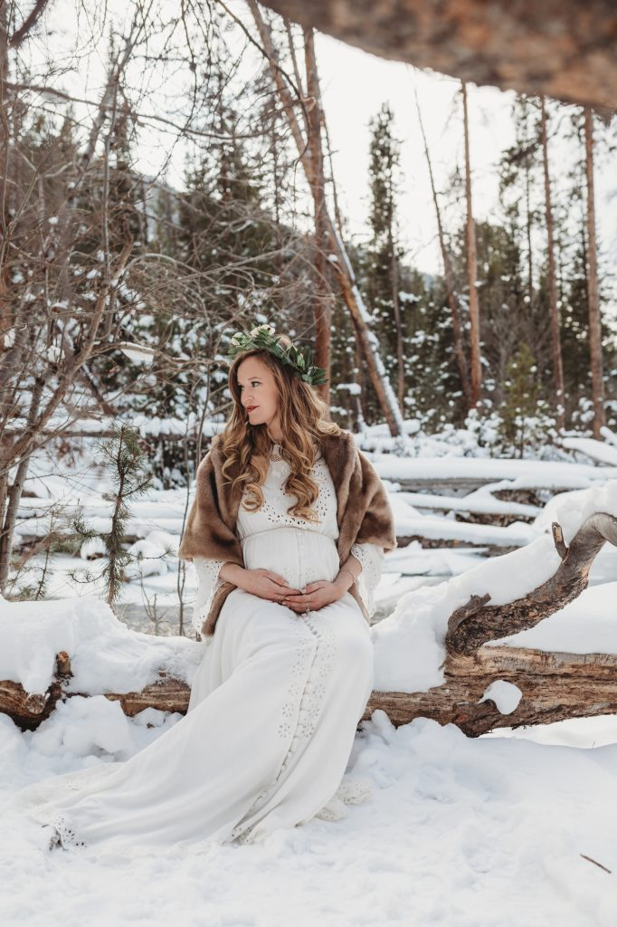 Shannon Jenkins of Upbeat Soles shows her snowy Colorado Maternity pictures with Fillyboo I Believe in Unicorns dress at Grand Lake Adams Falls