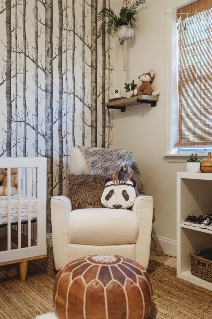 Shannon Jenkins of Upbeat Soles designs a woodland, boho baby boy nursery with DIY elements, gallery wall, teepee, leather pouf, and feather mobile
