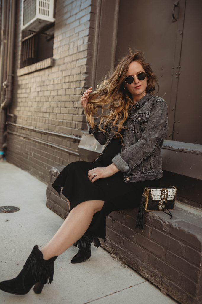 Shannon Jenkins of Upbeat Soles styles a maternity date night outfit with stretchy tank dress, Levi's grey denim jacket, and black fringe booties