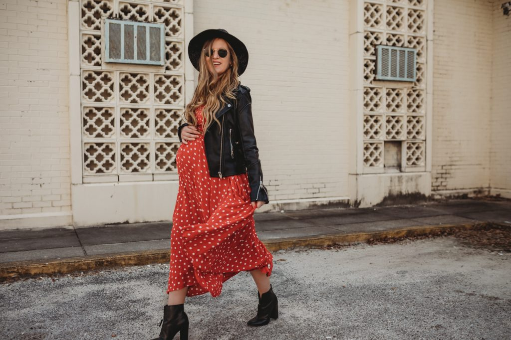 Shannon Jenkins of Upbeat Soles styles a boho maternity outfit with Free People polka dotted dress, Blank NYC leather jacket, and Ray Ban Icons
