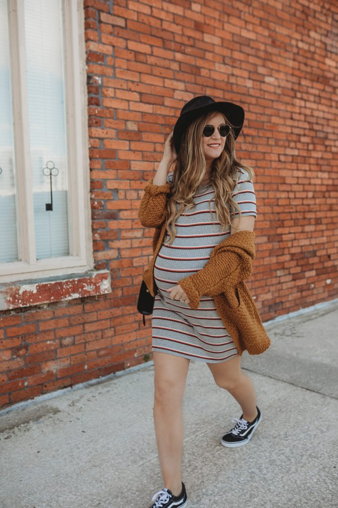 Shannon Jenkins of Upbeat Soles styles a sporty chic maternity outfit with striped Forever 21 dress, Old Skool Vans, and Sancia bag