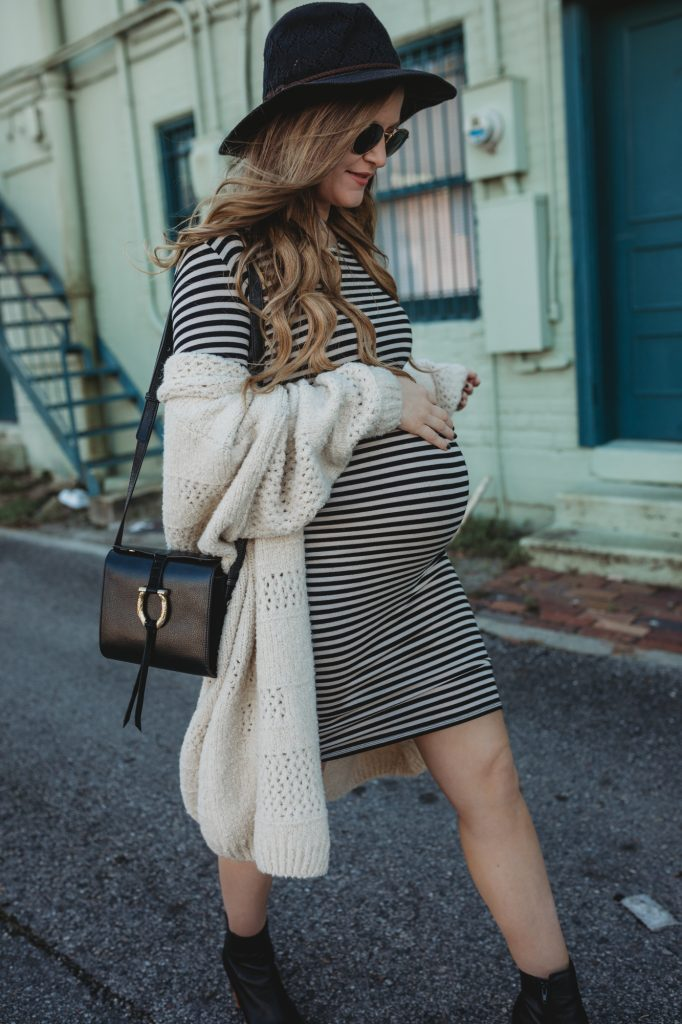 Shannon Jenkins of Upbeat Soles styles a stylish casual maternity outfit with a striped Forever 21 dress, long cardigan, and black ankle booties