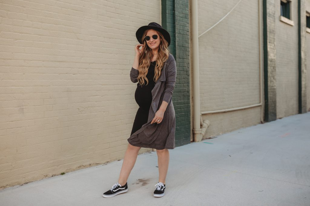 Shannon Jenkins of Upbeat Soles styles a casual laid back maternity outfit with Storq black stretchy maternity dress grey cotton cardigan and Vans Old Skool